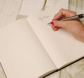 A woman's hand writing a list